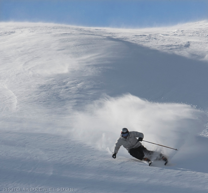 Steve Young skiing on hard-packed, wind-swept slope